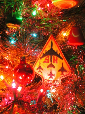 "The 507th Air Refueling Wing ""Okie"" patch is perched among the ornaments adorning this Christmas tree as wing Airmen pass on their Christmas greetings to all."