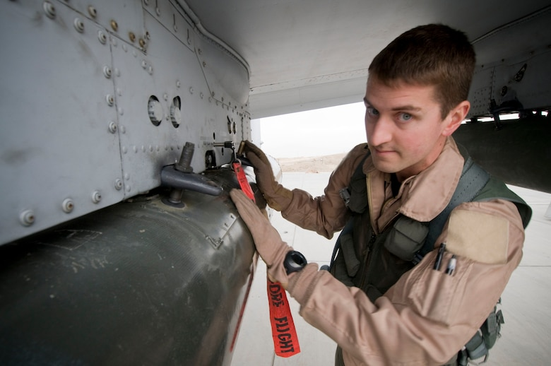 """Capt. Eric Fleming, Assistant Wing Weapons and Tactics and A-10 pilot, performs a preflight inspection of a GBU-12 at Bagram Air Field, Afghanistan, Dec. 2. As the pilot of the aircraft, he has the final authority to say the aircraft and its ordinance is """"good to go."""" Captain Fleming is deployed from Moody Air Force Base, Ga., and hails from Philadelphia, Pa. (U.S. Air Force photo by Staff Sgt. Samuel Morse)(Released)"""