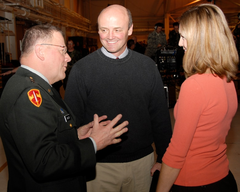 Maj. Gen. Larry Shellito, Minnesota Adjutant General, meets with KSTP-TV Photo Chief Joe Caffrey and News Anchor Leah McLean to congratulate them on their work in Afghanistan after the 133rd Airlift Wing 2008 Recognition Ceremony on Dec. 13, 2008 in St. Paul. The news team embedded with the 133rd AW to Afghanistan recently and did a series of stories on the Airmen, families and mission of the Minnesota Air National Guard unit.  (USAF photo by Tech. Sgt. Tyrell Heaton)