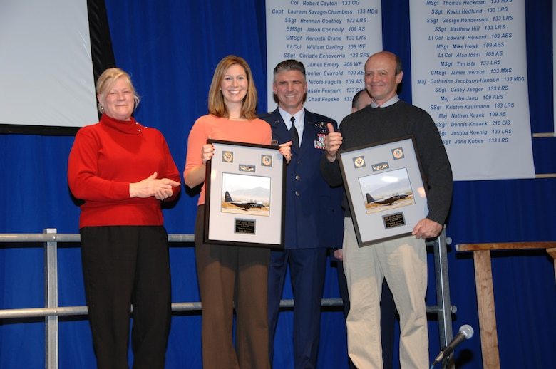 The 133rd Airlift Wing thanked News Anchor Leah McLean (second from left) and Photo Chief Joe Caffrey (right) of KSTP-TV when Minnesota Lt. Governor Carol Molnau (left) and Wing Commander Col. Greg Haase presented them a framed photo and certificate recognizing them as Honorary Airmen during the 133rd Airlift Wing 2008 Recognition Ceremony on Dec. 13, 2008 in St. Paul. The news team traveled to Afghanistan recently and did a series of stories on the Airmen, families and mission of the Minnesota Air National Guard unit.  (USAF photo by Tech. Sgt. John Wiggins)