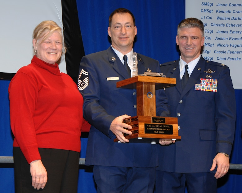Minnesota Lt. Gov. Carol Molnau (left) and 133rd Airlift Wing Commander Col. Greg Haase (right) present Senior Master Sgt. Steve Tuttle, 133rd Logistics Readiness Squadron, with the award for the Air National Guard Outstanding Fuels Management Flight of the Year. The award was earned for the previous year and presented during the 133rd AW's 2008 Wing Recognition Ceremony on Dec. 13, 2008 in a hangar at the St. Paul Air National Guard base. (USAF photo by Tech. Sgt. John Wiggins)