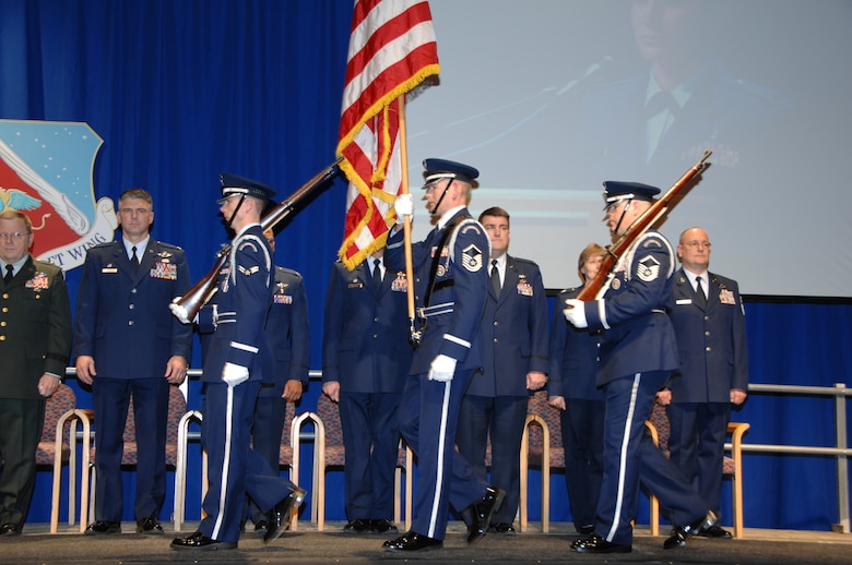 The 133rd Airlift Wing Honor Guard marches to display the colors in a hangar during the 133rd Airlift Wing Recognition Ceremony on Dec. 13, 2008. The Minnesota Air National Guard unit in St. Paul holds a ceremony every year recognizing the accomplishments of the Airmen, their families, and others in the community who make the 133rd AW very successful. (USAF photo by Tech. Sgt. John Wiggins)