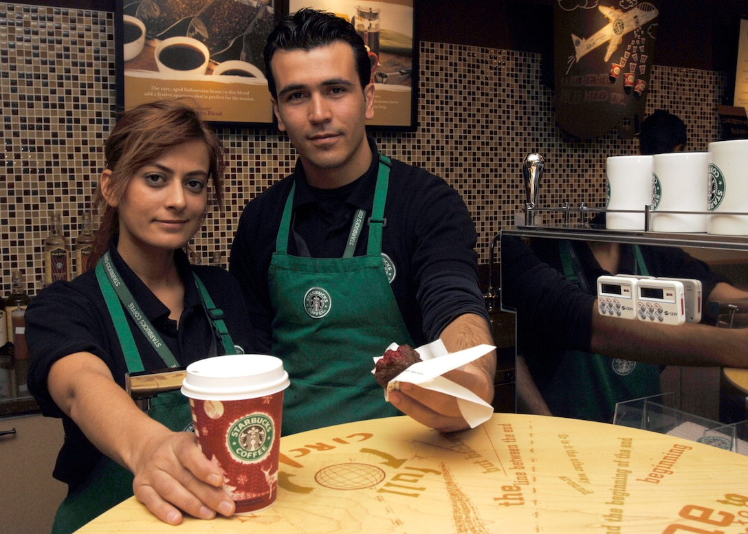 "Serpil Tawcav, Incirlik Starbucks barista, and Serkan Tecir, Incirlik Starbucks shift supervisor, present Starbucks products during the ""soft opening"" of Starbucks at Incirlik Dec. 21. This is the first Starbucks in United States Air Forces Europe. (U.S. Air Force photo by Master Sgt. Edward Holzapfel)"