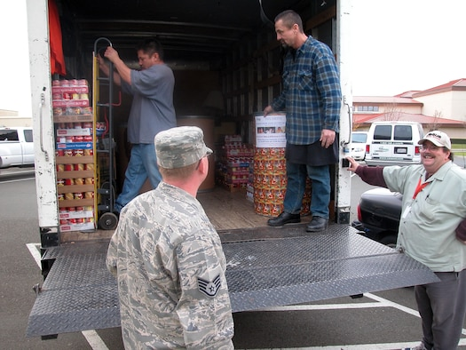 TRAVIS AIR FORCE BASE, Calif. -- Members of the 349th Air Mobility Wing donated more than 4,230 pounds of food to help feed the hungry this past Christmas season as part of the annual Wing Chaplain's Holiday Food Drive.  