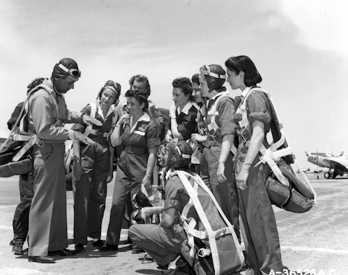 WASP trainees and their instructor pilot. (U.S. Air Force photo)