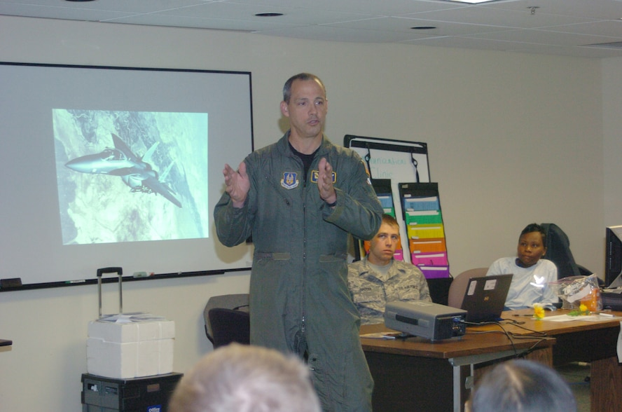 Col. Joseph Thomas, 94th AW vice commander, speaks on settingb the standard of accountability during a visit to gthe base clinic in November 2008.  (U.S. Air Force photo/Master Sgt. Stan Coleman)