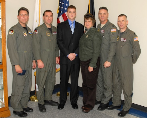 David Buckley, son of the late LtCol (ret) David Buckley, was sworn in as a UPT candidate here at Quonset ANGB, Saturday, 6 December 2008. David is following in his father's footsteps. LtCol Buckley, who flew with the 143d Airlift Wing for many years, passed away earlier this year. He would be very proud of his son's decision to join the 143d Operations Group. David is pictured with, from left to right, Col Ed Johnson, former C-130 Navigator, 143d Airlift Squadron (AS), LtCol Rick Hart, pilot, 143d AS, his mother Leslie Buckley, LtCol Arthur Floru, pilot, 143d Operations Support Flight Commander, and LtCol Gary Larson, pilot, 143d AS, all long time companions of David's father. We welcome him aboard. (USAF photo by Technical Sergeant Jason Long) (Released)