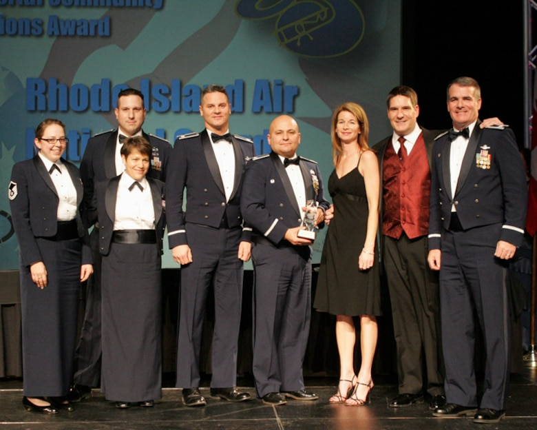 Members of the Rhode Island National Guard Open House and Air Show key staff with founding sponsor Mr. Al Cerrone and his friend Rita pose for a picture at the International Council of Air Shows Conference Chairman's Banquet in Las Vegas, Nevada. The RING Open House and Air Show was presented with the prestigious Dick Schram Community Service award. The RING Open House and Air Show is only one of 3 shows that have won this award twice. They were previously presented the award in 1995. (Released)