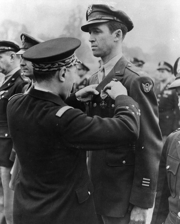 Lt. Gen. Valin, Chief of Staff, French Air Force, awards the Croix De Guerre with Palm to Col. Jimmy Stewart for exceptional services in the liberation. (U.S. Air Force photo)
