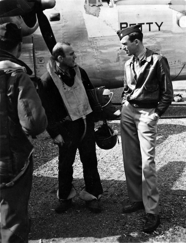 Maj. Jimmy Stewart confers with a B-24 crew member. (U.S. Air Force photo)