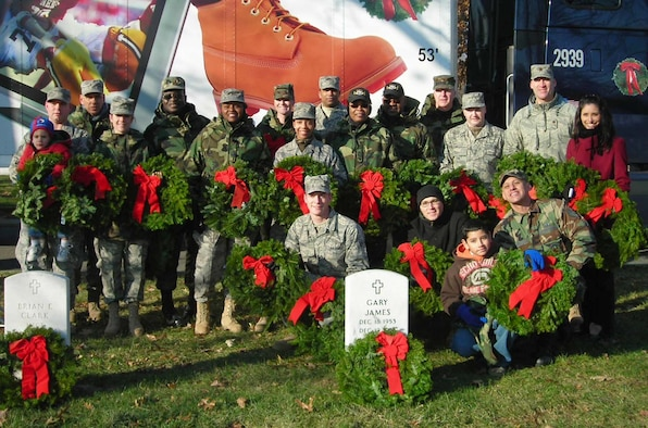 """Members of the 69th Aerial Port Squadron and their families gathered at Arlington National Cemetery Dec. 13 to take part in 17th annual """"Wreaths Across America"""" ceremony.  Across the United States, ceremonies took place in more than 200 other national and state veterans' cemeteries remembering, honoring and teaching about the service and sacrifices of the nations fallen heroes."""