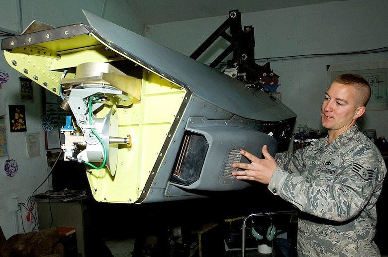 Staff Sgt. George Suonvieri checks out a Theater Airborne Reconnaissance System pod held in place by a giraffe stand at Joint Base Balad, Iraq, Dec. 21. TARS imagery helps ground commanders achieve tactical objectives. The dish in the foreground is a directional communications antenna. Suonvieri is one of four 332nd Expeditionary Aircraft Maintenance Squadron avionics maintainers responsible for the 332nd Expeditionary Fighter Squadron's TARS pods. Suonvieri, a native of Duluth, Minn., is deployed from the Minnesota Air National Guard's 148th Fighter Wing.