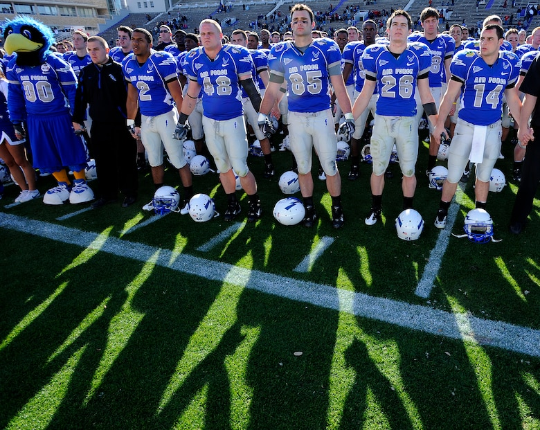U.S. Air Force Academy football players stand together in honoring alumni and fans at the conclusion of the Bell Helicopter Armed Forces Bowl game between the U.S. Air Force Academy and the University of Houston Dec. 31 in Fort Worth, Texas. Air Force lost to Houston, 34-28. (U.S. Air Force photo/Staff Sgt. Bennie J. Davis III)