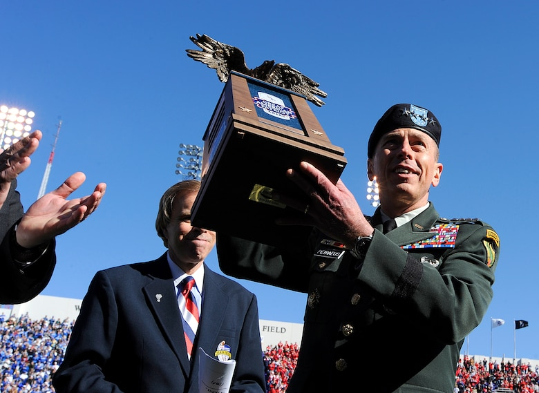 Gen. David Petraeus, U.S. Central Command commander, is honored with the Armed Forces Insurance Great American Patriot Award during half time of the Bell Helicopter Armed Forces Bowl game between the U.S. Air Force Academy and the University of Houston, Dec. 31 at Amon G. Carter Stadium in Fort Worth, Texas. (U.S. Air Force photo/Staff Sgt. Bennie J. Davis III)