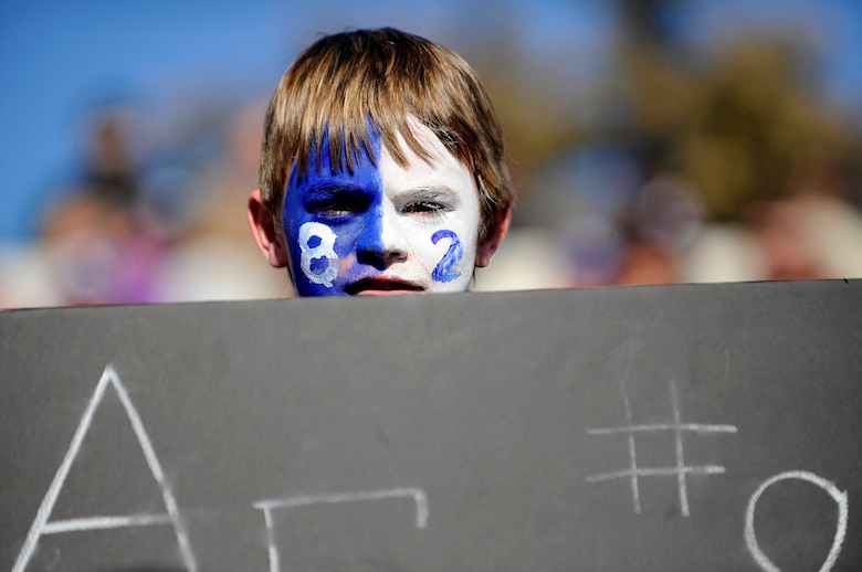 A young fan shows his team pride for Chaz Demerath, #82 of the U.S. Air Force Academy Falcons, during the Bell Helicopter Armed Forces Bowl game between the U.S. Air Force and the University of Houston Dec. 31 at Amon G. Carter Stadium, Fort Worth, Texas. (U.S. Air Force photo/Staff Sgt. Bennie J. Davis III)