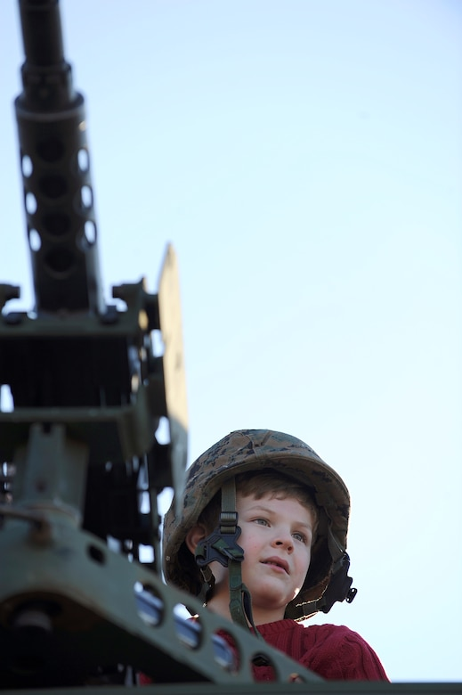 Jonathan Hardy, 6, sits atop an armored personnel vehicle at an U.S. Army exhibit during the Adventure Day celebration and pep rally Dec. 30 for the Bell Helicopter Armed Forces Bowl game between the U.S. Air Force Academy and the University of Houston at Amon G. Carter Stadium in Fort Worth, Texas.  (U.S. Air Force photo/Staff Sgt. Bennie J. Davis III)