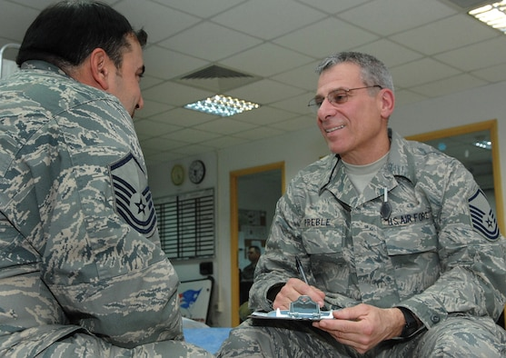 BALAD AIR BASE, Iraq -- Master Sgt. Robert Preble, deployed with the 439th Aeromedical Staging Squadron, talks with a fellow Airman. Sergeant Preble is a mental health technician deployed from Westover Air Reserve Base, Mass.