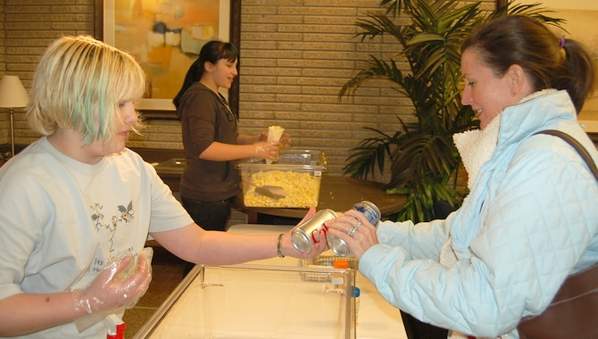 Rachel Trent, from the Peterson Youth Center, hands popcorn and soda to Mrs. Nancy Diel Feb. 1 during free movie nights at the base theater. Sponsored by the 21st Services Squadron, members with access to the base can enjoy free, newly-released movies and discounted snacks and beverages each week. Mrs. Diel is married to Lt. Col. Todd Diel who is assigned to Air Force Space Command. (U.S. Air Force photo/Corey Dahl)