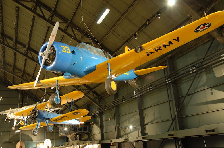 DAYTON, Ohio -- Vultee BT-13B Valiant (foreground) and Stearman PT-13D Kaydet in the World War II Gallery at the National Museum of the United States Air Force. (U.S. Air Force photo)
