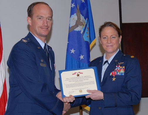 Major Jean Havens, 14th Operations Support Squadron Director of Operations, was awarded the Bronze Star Jan. 31 by Col. Dave Gerber, 14th Flying Training Wing commander. Havens received this medal for her role in advising a squadron of Iraqi pilots.  (U.S. Air Force photo by Melissa Duncan)
