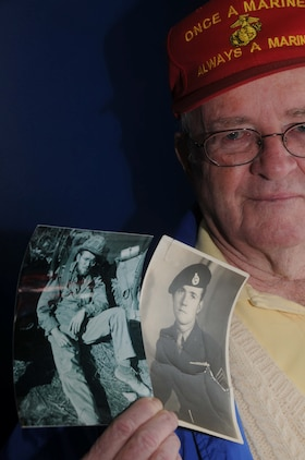 "Former Cpl. Daniel Sharkey displays photos taken of himself as a young Marine.  Sharkey participated in the Chosin Reservoir campaign as an Air and Naval Gunfire Liaison Company representative attached to 2nd Battalion, 5th Marine Regiment, 1st Marine Division, and was among the first to be interviewed for the documentary, ""Chosin."""