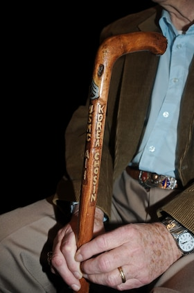"Former Staff Sgt. Richard Gilbert displays a cane he had made that identifies the unit he served with during the Chosin Reservoir campaign; Alpha Company, 1st Battalion, 1st Marines Regiment, 1st Marine Division.  Gilbert was interviewed by Capt. Iglesias for the documentary ""Chosin."""