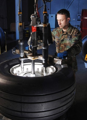 Staff Sgt. Greg Thompson, an aircraft mechanic from the Aero Repair Shop at March Air Reserve Base, Calif., uses a wheel and tire assembly fixture and torquing machine Feb. 3 to mount a tire on a C-17 Globemaster III cargo aircraft wheel.  March ARB, located in Southern California, is home to the largest air mobility wing in the Air Force Reserve Command. It also is home to units from the Army Reserve, Navy Reserve, Marine Corps Reserve and Air National Guard. (U.S. Air Force photo/Val Gempis)