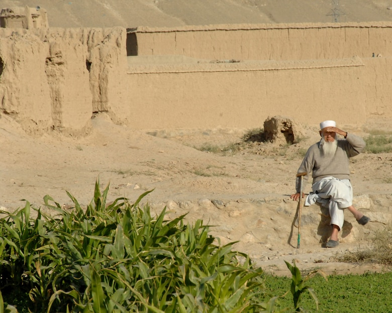 A villager watches an International Security Assistance Force patrol pass through his village October 2007. (ISAF photo by Master Sgt. Russell P. Petcoff)