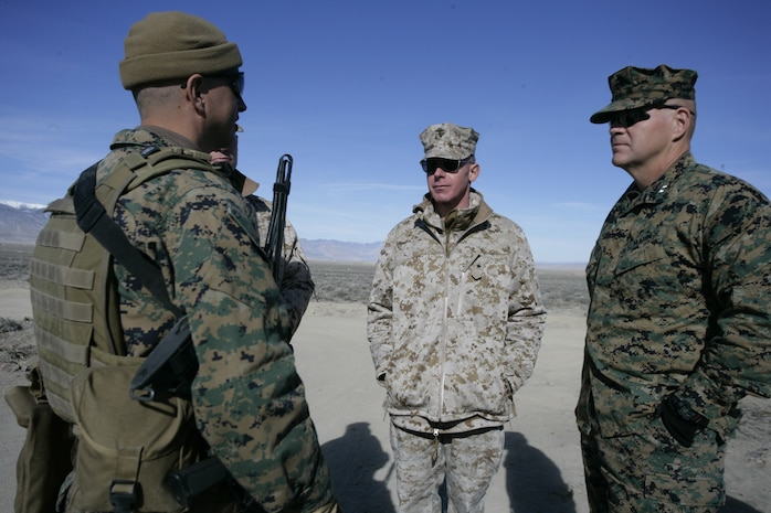 Brig. Gen. Melvin G. Spiese, commanding general of Marine Corps Air Ground Combat Center Twentynine Palms, Calif., and Maj. Gen. Robert B. Neller, commanding general of 3rd Marine Division, meets with Lt. Col. Anthony Terlizzi, Embedded Trainer Team 4-3 officer-in-charge, Feb. 9, 2008, aboard U.S. army training grounds in Hawthorne, Nev.  Spiese and Neller paid a visit to Marines with trainer teams executing a 21-day long pre-deployment training evolution dubbed Mountain Viper.  ETTs serving in 3rd Marine Division are preparing for an upcoming deployment to Afghanistan where they will be tasked with mentoring, training and advising the Afghan National Army to become a self-efficient force.  (U.S. Marine Corps photo by Cpl. Michael S. Cifuentes)
