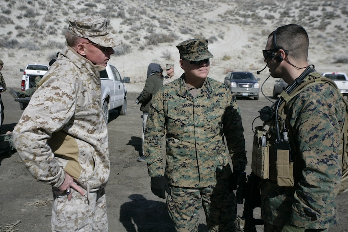 Brig. Gen. Melvin G. Spiese, commanding general of Marine Corps Air Ground Combat Center Twentynine Palms, Calif., and Maj. Gen. Robert B. Neller, commanding general of 3rd Marine Division, talks to a U.S. Marine with Embedded Trainer Team 2-6 aboard U.S. army training grounds Feb. 9, 2008, in Hawthorne, Nev.  Spiese and Neller paid a visit to Marines with trainer teams executing a 21-day long pre-deployment training evolution dubbed Mountain Viper.  ETTs serving in 3rd Marine Division are preparing for an upcoming deployment to Afghanistan where they will be tasked with mentoring, training and advising the Afghan National Army to become a self-efficient force.  (U.S. Marine Corps photo by Cpl. Michael S. Cifuentes)
