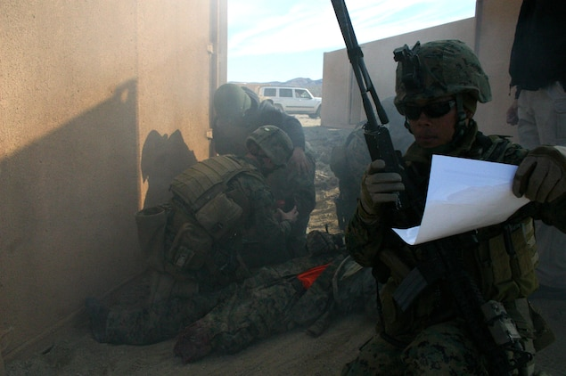 A U.S. Marine with Embedded Trainer Team 4-3 calls for a helicopter over the radio to evacuate mock-casualties during combat casualty care training aboard a military operations in urban terrain facility in Hawthorne, Nev., Feb. 9, 2008.  ETTs serving under 3rd Marine Division are training for an upcoming deployment to Afghanistan where they?ll be tasked with mentoring, training and advising the Afghan National Army to become a self-efficient military force.  The teams are in the final phase of the 21-day long pre-deployment evolution dubbed Mountain Viper. (U.S. Marine Corps photo by Lance Cpl. Uriel De Luna-Felix)