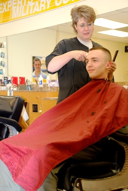 Karen Koch, civilian barber, performs a haircut for 1st Lt. Joe Liles, 90th Operations Group, at the BX barbershop Jan. 31. The barbershop is open Monday through Friday from 8 a.m. to 6 p.m. (U.S. Air Force photo/Airman 1st Class Daryl Knee).