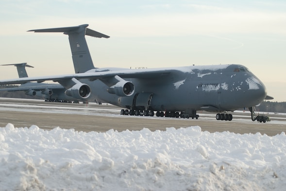 Parked around the New England snow, a 439th Airlift Wing C-5B Galaxy awaits its next mission at Westover. Sixteen of the Air Force's largest aircraft are assigned to the base.