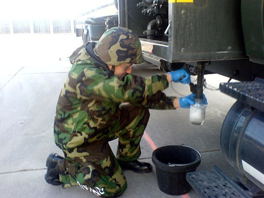 Staff Sgt. Joel Noell from the 507th Mission Support Group Logistics Readiness Squadron's Petroleum, Oil and Lubricant (POL) section draws a sample from a fuel truck to conduct a visual examination.