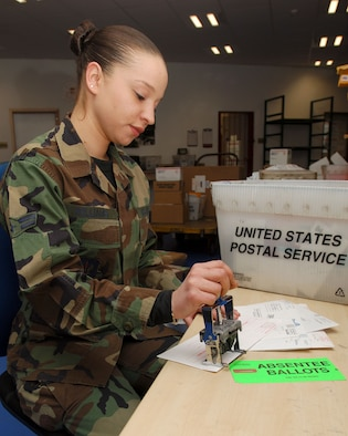 Airman 1st Class Tiffany Williams, 435th Communications Squadron, stamps absentee ballots at the Northside Post Office Feb. 7. The 2d Air Postal Squadron is working hard every day to ensure all of U.S. Air Forces in Europe votes are counted. Photo by Senior Airman Melissa Sheffield
