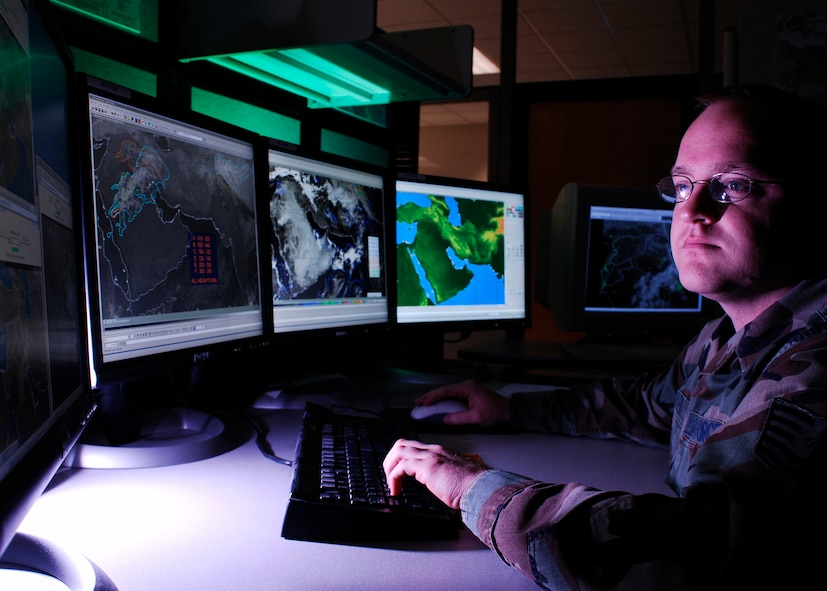 Tech. Sgt. Jason Miller, from Irving, Texas, analyzes cloud bases for Southwest Asia. Miller is a 16-year Air Force veteran and has spent the last four years at the Air Force Weather Agency at Offutt Air Force Base, Neb. The 35 year old is NCO in charge of the 2nd Weather Squadron's Southwest Asia Obscurant Forecast and Analysis Cell, a new program developed to provide regional specific data. (Photo by G. A. Volb)