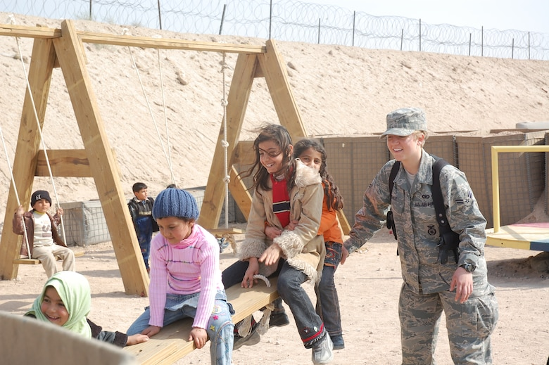CAMP BUCCA, Iraq – Airman 1st Class Sarah Coble, 886th Expeditionary Security Forces Squadron, plays with children who are visiting family and friends detained in the Theater Internment Facility in Camp Bucca, Iraq, Feb. 10, 2008.  Airmen deployed to the 886th ESFS operate the TIF's vigorous visitation program which houses detainees determined to be a security threat against Iraqi citizens or coalition forces. More than 1,700 friends and family members visit the detainees each week. Airman Coble is deployed from Keesler Air Force Base, Miss. (U.S. Air Force Photo/Capt. Jason McCree)