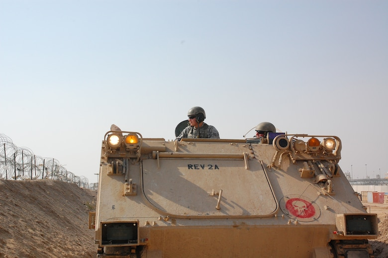 CAMP BUCCA, Iraq – Senior Airman Travis Hummel, left, and Airman 1st Class Adam Giebitz patrol in an M-113 Armored Personnel Carrier at the Theater Internment Facility in Camp Bucca, Iraq, Feb. 10, 2008. Airmen Hummel and Giebitz are deployed from Robins Air Force Base, Ga., and are assigned to the 886th Expeditionary Security Forces Squadron's quick response force.  The QRF responds to issues within the TIF in which a show of force or escalation of force is required beyond the capabilities for the TIF's guard force.  (U.S. Air Force Photo/Capt. Jason McCree)