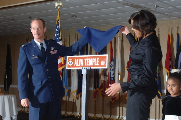 Colonel Dave Gerber, 14th Flying Training Wing commander, unveils the street sign in honor of Lt. Col. Alva Temple, a Tuskegee Airmen, at the Black History Luncheon. The colonel was accompanied by the family of Colonel Temple. (U.S. Air Force photo by Airman 1st Class Danielle Hill)