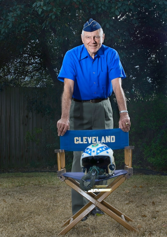"Retired Lt. Gen. Charles G. Cleveland stands in his backyard behind a director's chair presented to him as a gift for his time as the commander of the Air University at Maxwell Air Force Base, Ala. General Cleveland has been recognized by the Air Force as a jet fighter ace 55 years after the end of the Korean War. Newly discovered documentation by the Russian air force as well as eyewitness accounts by General Cleveland's wingmen proved evidence to support converting two probable kills into confirmed kills from dog fights over ""Mig Alley"" during the Korean War. General Cleveland was deployed to South Korea in March 1952, where he flew F-86s as a flight commander with the 4th Fighter Interceptor Wing at Kimpo Air Base. (U.S. Air Force photo/Staff Sgt. Bennie J. Davis III)"