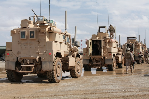 A convoy of U.S. Marine Corps mine-resistant, ambush-protected vehicles drives down a road near Camp Leatherneck, Afghanistan, March 5, 2011. More than 50 Marines assigned to Marine Wing Support Squadron 373 returned to Camp Leatherneck after completing an independent convoy to Camp Dwyer, Afghanistan.