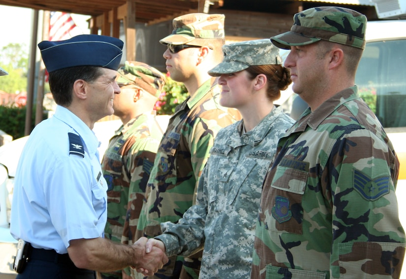 SOTO CANO AIR BASE, Honduras-- Air Force Col. Sean Murphy, U.S. SOUTHCOM command surgeon, shakes hands with the men and women carrying out the medical mission of Joint Task Force-Bravo. During a Feb.14 formation here, Colonel Murphy passed on his appreciation and gratitude for the work MEDEL personnel do in the region. (U.S. Air Force photo by Staff Sgt. Luis Santa)