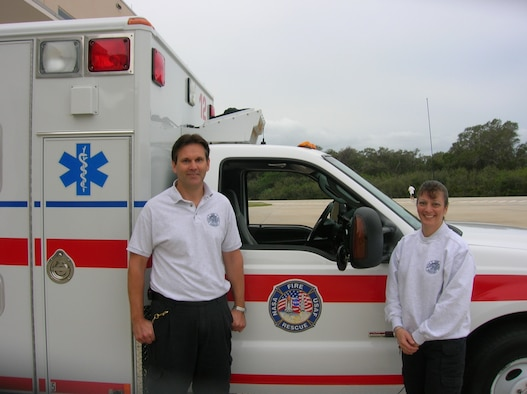 Dan Robiataille (left) and Michelle LaMoia of the Space Gateway Support Emergency Response Team with their ambulance at Cape Canaveral AFS. (Photo courtesy of Space Gateway Support)