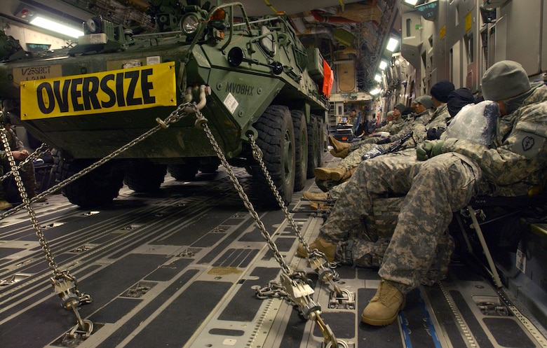 The flight from Eielson AFB, AK to the Republic of Korea is about 9 hours, so the members of the US Army's First Stryker Brigade Combat Team of the 25th Infantry Division, 1st Battalion 24th Infantry Regiment, Charlie Company from Fort Wainwright, Alaska rest along side their Stryker Vehicle prior to their journey aboard the C-17 Globemaster III that will transport them and their equipment to the Republic of Korea in support of the Foal Eagle exercise. It is the first time the USAF and US Army in Alaska has used joint assets to project combat power protection out of Alaska. The C-17 Globemaster III and its crew members are from the 517th Airlift Squadron, Elmendorf AFB, Alaska.  (U.S Air Force photo by: Staff Sgt Eric T. Sheler)