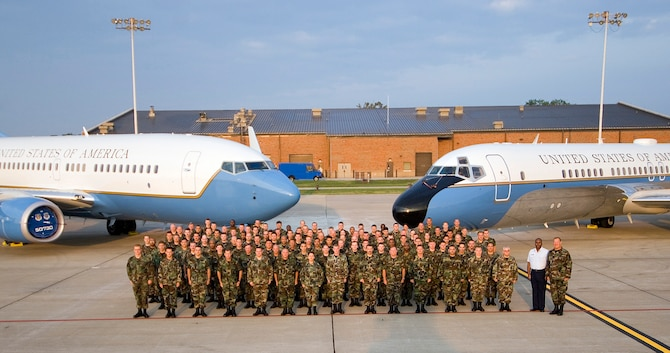 The maintenance members of the 932nd Airlift Wing, an Air Force Reserve Command unit, standby next to the two planes they maintain.  At left is the C-40C and at right is the C-9C.  Call 1-800-257-1212 for more information on openings and training required.