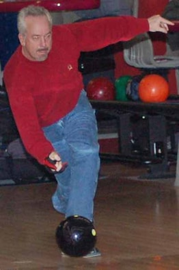 DISA bowler Mike Wang throws a  strike in a match against Hellfino at the Tinker Bowling Center on Feb 6. THe match between the two top teams in the league resulted in a draw.