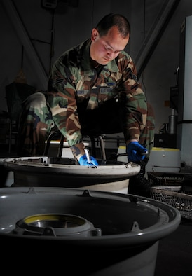 Airman 1st Class Jonathan Centers, an aircraft mechanic from the Aero Repair Shop, uses a  ratchet wrench to install heat shied on a KC-135 Stratotanker refueling aircraft main wheel at March Air Reserve Base, Calif., on Feb. 3, 2008. March Air Reserve Base, located in Southern California, is home to the largest air mobility wing in the Air Force Reserve Command. It is also home to units from the Army Reserve, Navy Reserve, Marine Corps Reserve and Air National Guard. (U.S. Air Force photo by Val Gempis)