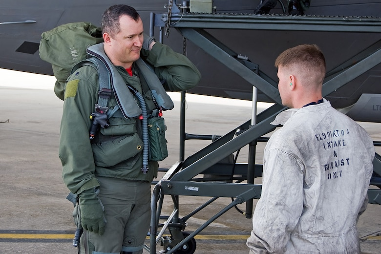 TYNDALL AIR FORCE BASE, Fla. -- Lt. Col. Mike Shower, 90th Fighter Squadron commander, speaks with Staff Sgt. Charlie Grantham, 90th Aircraft Maintenance Unit, after completing a training sortie. The 3rd Wing and Air Force Reserve Command's 477th Fighter Group combined for its first F-22A Raptor deployment to Tyndall Air Force Base, Fla., for Combat Archer. The successful integration of both reserve and active-duty Airmen was showcased Feb. 2-17, when approximately eight aircraft and 132 Airmen took part in the Weapons System Evaluation Program training. (Photo by Scott Wolfe)