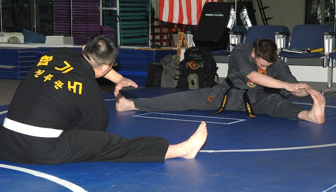 FAIRCHILD AIR FORCE BASE, Wash. -- Staff Sergeant Thomas Locke, begins his Combat Hapkido class with stretches at the base Fitness Center on Feb. 5. Sergeant Locke has been studying Combat Hapkido for five years, but has studied several other martial arts for more than twelve. The Combat Hapkido class, which teaches self defense, is offered Tuesdays and Thursdays from 6 to 8 p.m. at the Fitness Center. (U.S. Air Force photo / Senior Airman Jocelyn Ford)