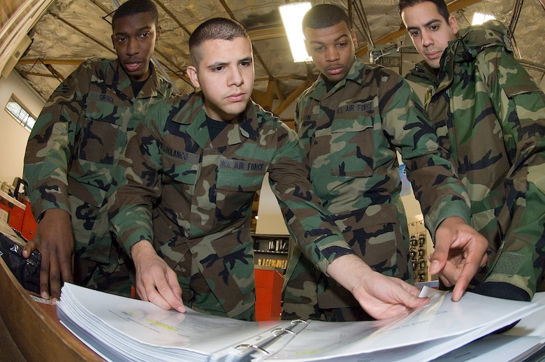 Pipeline students, from left to right, Airman Major Grace, Airman Basic Chris Polanco, Airman 1st Class Rickey Martin and Airman 1st Class Erik Silva review a technical order index binder prior to checking out equipment from the 62nd Aircraft Maintenance Squadron's consolidated tool kit shop.